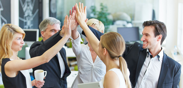 39539640 - happy business team making high five with their hands in the office