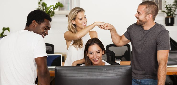 34397532 - technology startup team celebrates good news in their office