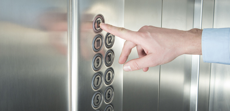 51293279 - human hand pressing the last floor button in the elevator