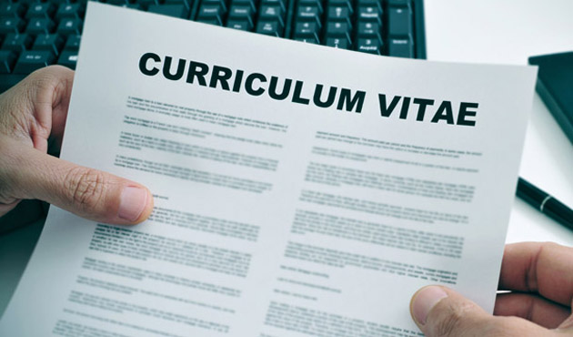 28029904 - man in his office checking a curriculum vitae