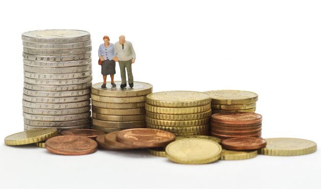 19795023 - seniors figurines with euro coins isolated on white background