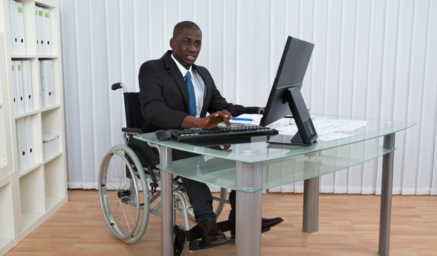 Businessman Working In Office Sitting On Wheelchair