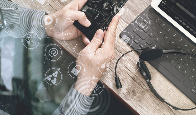 top view of man hand using VOIP headset with digital tablet comp