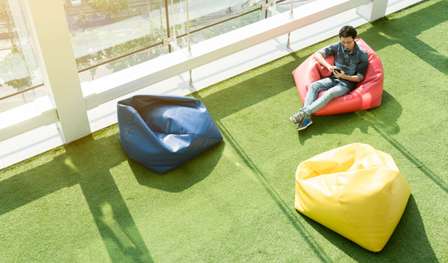 Man use smartphone on bean bag in afternoon, freelance conceptua