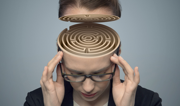 Conceptual image of a maze in the woman's brain